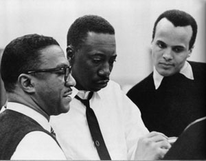 Leonard De Paur, Joe Williams, and Harry Belafonte reviewing a take, C. 1961